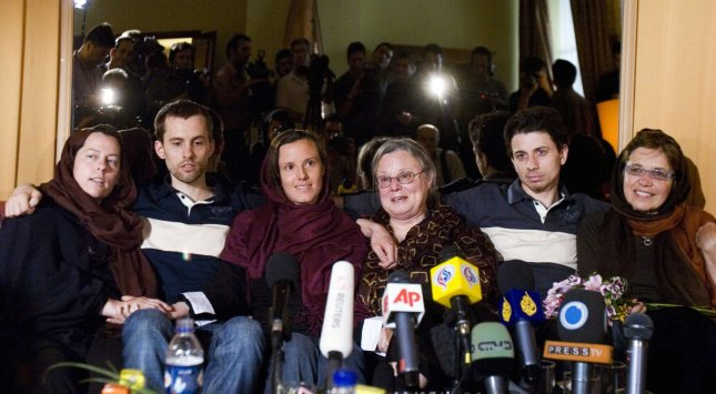 Freed American hilkers Shane Bauer (2nd-L), Sarah Shourd (3rd,L) and Josh Fattal (2nd,R) sit with their mothers Cindy Hickey (L), Nora Shourd (4th,L) and Laura Fattal (R) during a reunion at a hotel in northern Tehran, Iran on May 20, 2010. The mothers of the three then-jailed Americans arrived on Wednesday in Tehran and was received by the ambassador of the Swiss embassy,which represents the interests of the U.S. with Iran. UPI/Maryam Rahmanian