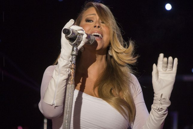 Singer Mariah Carey performs during the 91st National Christmas Tree Lighting Ceremony on the Ellipse south of the White House in Washington, DC, on December 6, 2013 (File/UPI/Jim Lo Scalzo/Pool)