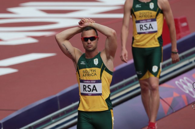 South Africa's Oscar Pistorius holds his head in his hands at the London 2012 Summer Olympics on August 9, 2012. (UPI/Hugo Philpott)