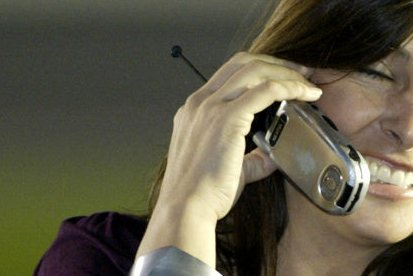 A woman talks on a cell phone (File/UPI Photo/Nell Redmond)