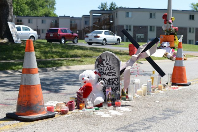 A makeship memorial has been established in the middle of the street in Ferguson, Missouri for the teen that was slain there by a Ferguson policeman on August 9, 2014. Michael Brown was shot numerous times after an apparent stuggle with the officer, setting off several days of protests and vandalism. UPI/David Broome