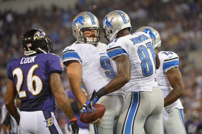 Former Detroit Lions wide receiver Calvin Johnson (81) celebrates with quarterback Matthew Stafford after bringing in a touchdown pass against the Baltimore Ravens during the second quarter at M&T Bank Stadium on August 17, 2012 in Baltimore, Maryland. UPI/Kevin Dietsch