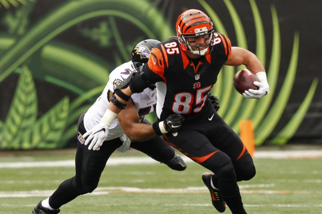 Cincinnati Bengals tight end Tyler Eifert (85) fights to break free from Baltimore Ravens' Daryl Smith (51) during the first half of play at Paul Brown Stadium in Cincinnati, Ohio, January 3, 2016. Photo by John Sommers II/UPI