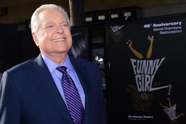 TCM host Robert Osborne arrives for the world premiere of the 45th Anniversary Restoration of Funny Girl at the Opening Night Gala of the 2013 TCM Classic Film Festival in Los Angeles on April 25, 2013. Osborne has died at the age of 84, TCM announced Monday.File Photo by Jim Ruymen/UPI