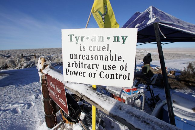 An activist performs sentry duty at the Malheur National Wildlife Reserve on January 15, 2016 in Burns, Oregon. Militia leader Ammon Bundy and several other protesters occupied the refuge two weeks earlier to support the imprisoned local ranchers and protest federal management of land. Friday, an Oregon jury convicted two occupiers and acquitted two others on a conspiracy charge. File Photo by Jim Bryant/UPI