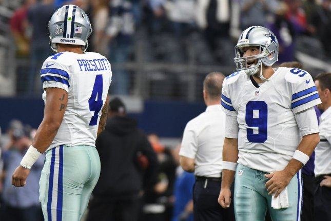 Dallas Cowboys quarterback Tony Romo (R) talks to his former backup Dak Prescott as they warm up prior to facing the Baltimore Ravens in 2016. File Photo by Ian Halperin/UPI