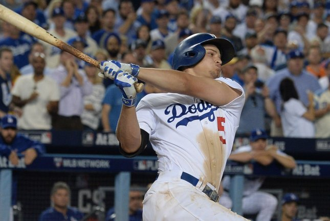 Los Angeles Dodgers' Corey Seager hits the ball. Seager had his first-career walk-off hit against the Reds on Saturday night. File photo by Jim Ruymen/UPI