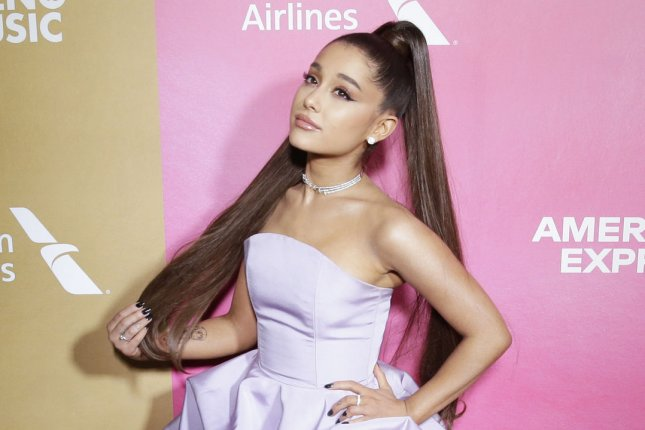 Ariana Grande posted a clip of her pink-hued video for 7 Rings. File Photo by John Angelillo/UPI