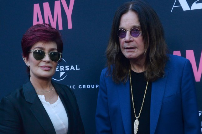 Ozzy Osbourne (R) with his wife Sharon Osbourne. The rock legend has postponed all of his 2019 tour dates. File Photo by Jim Ruymen/UPI
