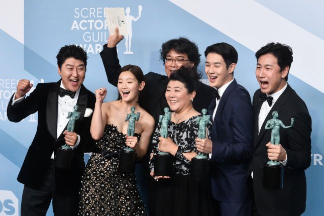 From left to right, Parasite cast members Song Kang Ho, So-dam Park, Jeong-eun Lee, Sun-kyun Lee, Woo-sik Choi, and director Bong Joon-ho appear backstage with the SAG Award for Outstanding Performance by a Cast in a Motion Picture  on Sunday in Los Angeles. Photo by Jim Ruymen/UPI