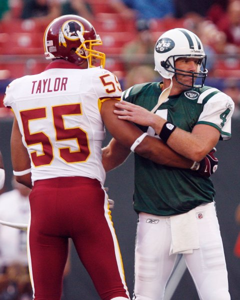 New York Jets Brett Favre and Washington Redskins Jason Taylor grab each other in the first quarter at Giants Stadium in East Rutherford, New Jersey on August 16, 2008. (UPI Photo/John Angelillo) .