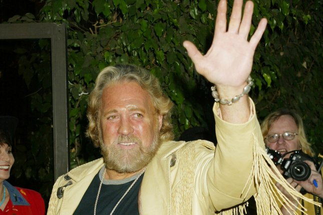 Dan Haggerty waves to photographers at the 22nd Annual Golden Boot Awards in Los Angeles on August 7, 2004. The actor, best known for his role as Grizzly Adams, has died at the age of 74 during a battle with cancer. File Photo by Francis Specker/UPI