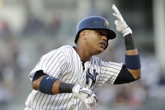 New York Yankees' Starlin Castro reacts rounding third base after hitting a 2-run home run in the 2nd inning against the Baltimore Orioles at Yankee Stadium in New York City on July 19, 2016. Photo by John Angelillo/UPI