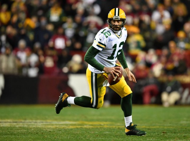 Green Bay Packers quarterback Aaron Rodgers (12) has a 100.3 career postseason passer rating, making him one of four quarterbacks in NFL history to have a 100 rating (minimum 150 attempts). File Photo by Kevin Dietsch