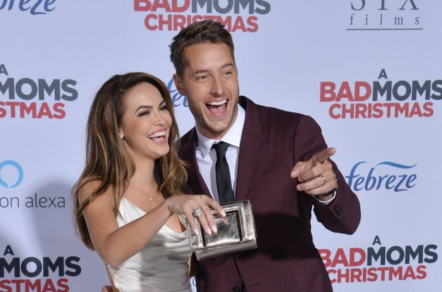 Justin Hartley (R) and Chrishell Stause attend the Los Angeles premiere of A Bad Moms Christmas on Monday. Photo by Jim Ruymen/UPI