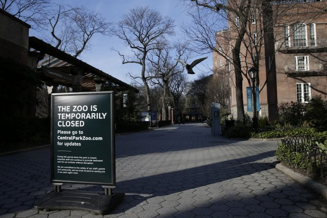A sign informs the public on March 26 that New York City's Central Park Zoo is closed due to conditions brought on by the coronavirus pandemic. Photo by John Angelillo/UPI