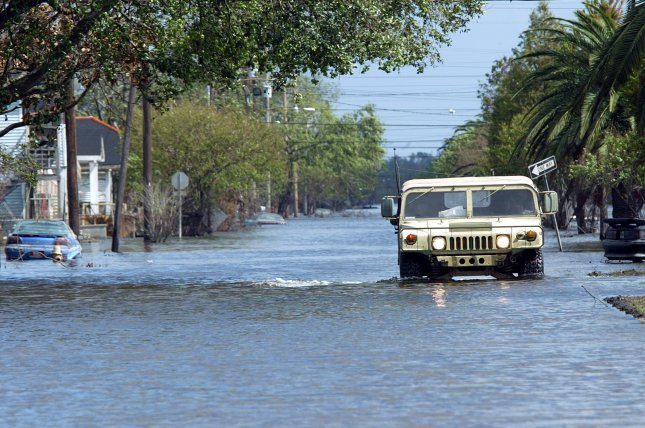 A military vehicle makes it's way down a flooded St. Bernard Street in Louisiana on September 25, 2005, after the region swapped by Hurricane Rita. The storm made landfall on September 24, 2005. File Photo by A.J. Sisco/UPI