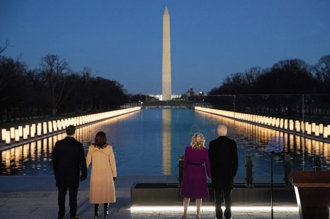 U.S. President-elect Joe Biden, wife Jill Biden, U.S. Vice President-elect Kamala Harris, and husband Douglas Emhoff attend an event at the Lincoln Memorial honoring those who have died during the COVID-19 pandemic. Photo by Al Drago/UPI
