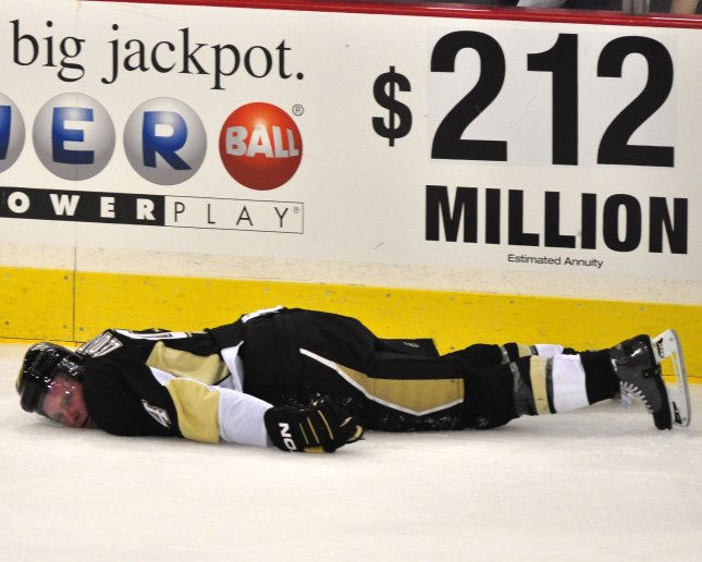 Pittsburgh Penguins defenseman Jordan Leopold is knocked into the boards by defenseman Andy Sutton, then with the Ottawa Senators, and falls in the ice cold in first period of game two of the NHL Eastern Conference Quarter Final at Mellon Arena in Pittsburgh, April 16, 2010. UPI/Archie Carpenter