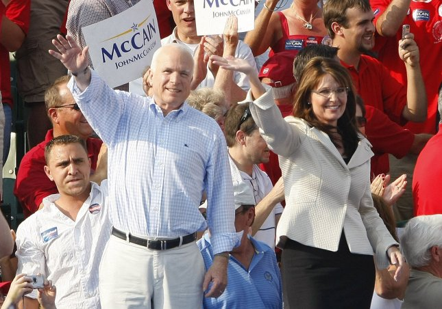 Republican President and Vice Presidential candidates Sen. John McCain and Gov. Sarah Palin wave to the crowds during a rally at the T.R. Hughes Ballpark in O'Fallon, Missouri on August 31, 2008. (UPI Photo/Bill Greenblatt)