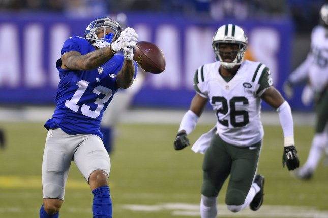 New York Giants wide receiver Odell Beckham (13) drops a pass in the 4th  quarter as New York Jets cornerback Darrin Walls (26) looks on against the New  York ... 10ce07676
