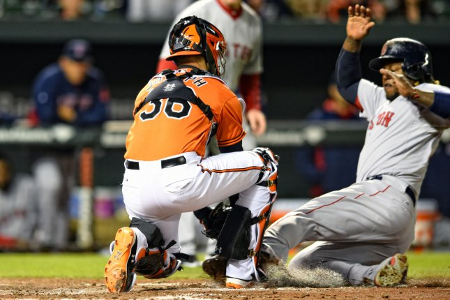 Boston Red Sox left fielder Hanley Ramirez (13) is thrown out at the plate at Camden Yards in Baltimore, MD. on April 25, 2015. Photo by Mark Goldman/UPI