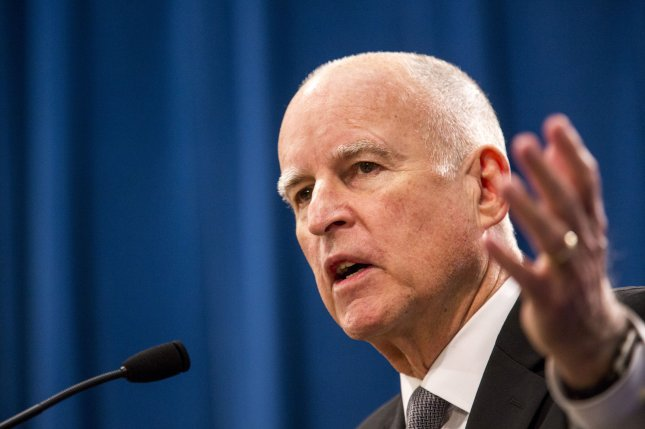 California Gov. Jerry Brown, a Democrat, signed legislation Friday that seeks federal permission for undocumented immigrants to participate in the state's insurance exchange. File photo by Ken James/UPI