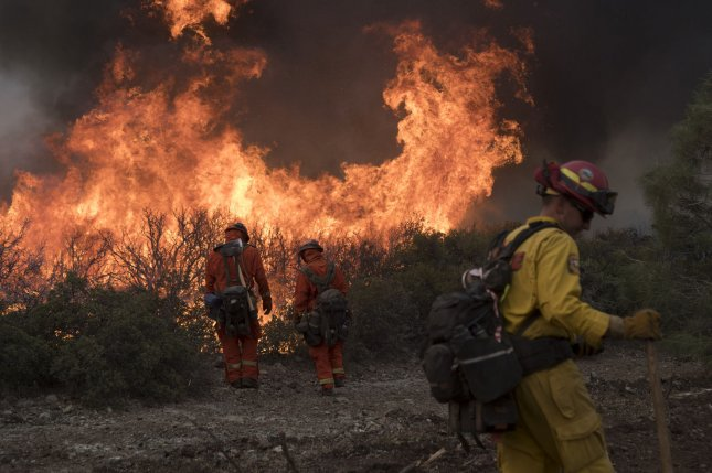 Firefighters set a backfire along a ridge in Colusa County, California, August 7 while fighting the Mendocino Complex Fire, which grew to the largest fire in the state's history. Photo by Terry Schmitt/UPI