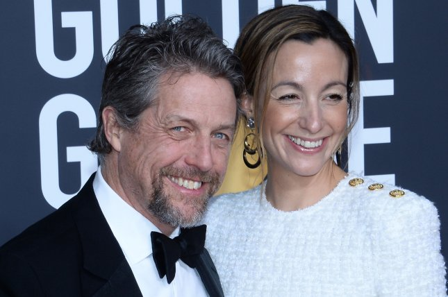 Hugh Grant (L), pictured with Anna Eberstein, appealed to fans after someone broke into his car and stole a bag. File Photo by Jim Ruymen/UPI