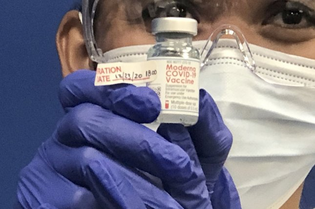 Leonida Lipshy, a registered nurse COVID-19 unit at the Broward Health Medical Center-Imperial Point, in Fort Lauderdale, Fla., displays a bottle of the Moderna COVID-19 vaccine on Wednesday. Photo by Gary I Rothstein/UPI