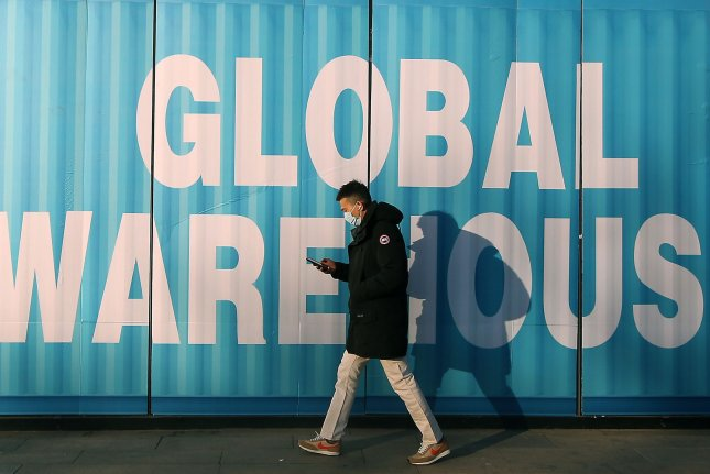 A man walks past an international goods market in Beijing, China on January 9. Tuesday's report said the U.S. deficit with China widened by almost $7 billion to nearly $37 billion during the month of March. File Photo by Stephen Shaver/UPI