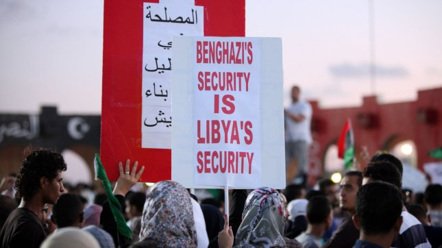 Shows Libyan protesters holding placards during march an anti hardline Islamist in Benghazi, Libya, 22 September 2012. Hundreds of Libyan protesters forced members of a hardline Islamist militia out of their base in the second city of Benghazi, setting fire to and wrecking the military compound. UPI/Tariq AL-hun.