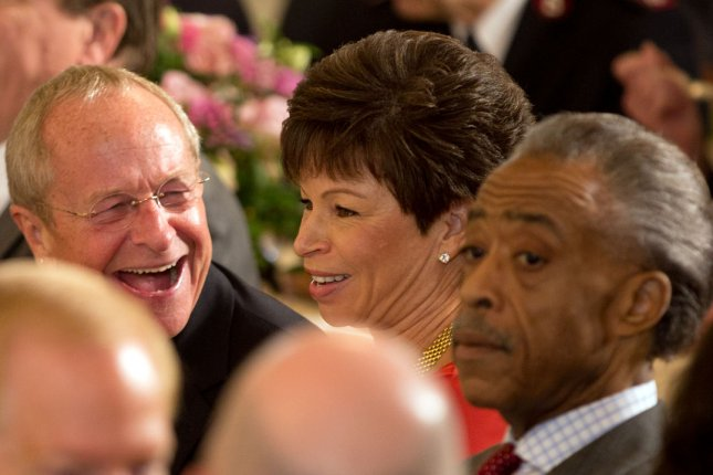 Bishop Gene Robinson (L), the first openly gay bishop, shares a laugh with Senior Adviser to the president Valerie Jarrett during an Easter Prayer Breakfast hosted by President Barack Obama in the East Room of the White House, in Washington, Monday, April 14, 2014. At right is the Reverend Al Sharpton. UPI/Martin Simon/Pool