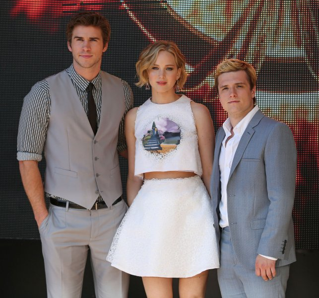 Liam Hemsworth (L), Jennifer Lawrence (C) and Josh Hutcherson arrive at a photo call for the film The Hunger Games: Mockingjay Part 1 at the Hotel Majestic in Cannes, France on May 17, 2014. UPI/David Silpa
