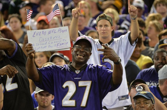3dff9fc3fe3 A Baltimore Ravens fan holds up a sign supporting Ray Rice as the Ravens  play the Pittsburgh Steelers at M&T Bank Stadium in Baltimore, ...