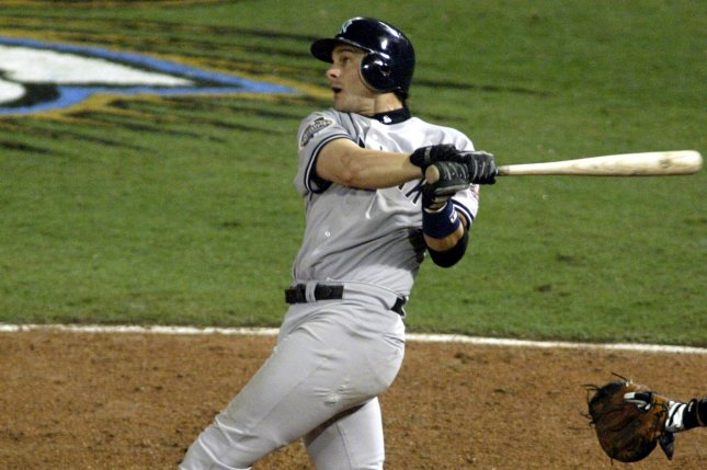 New York Yankees' Aaron Boone watches his home run clear the fence en route to a 6-1 victory over the Florida Marlins in Game 3 of the 2003 MLB World Series. File photo by Michael Bush/UPI