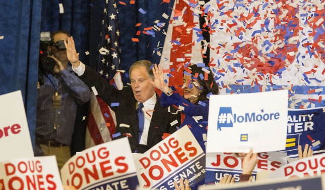 Victorious Democratic Senate candidate Doug Jones arrives on stage at an election night rally in Montgomery, Ala., Tuesday night after winning the close race over Republican Roy Moore. Photo by Mark Wallheiser/UPI