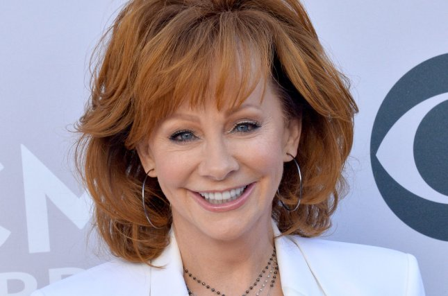 Recording artist Reba McEntire appears as Colonel Sanders in KFC's new commercial. File Photo by Jim Ruymen/UPI