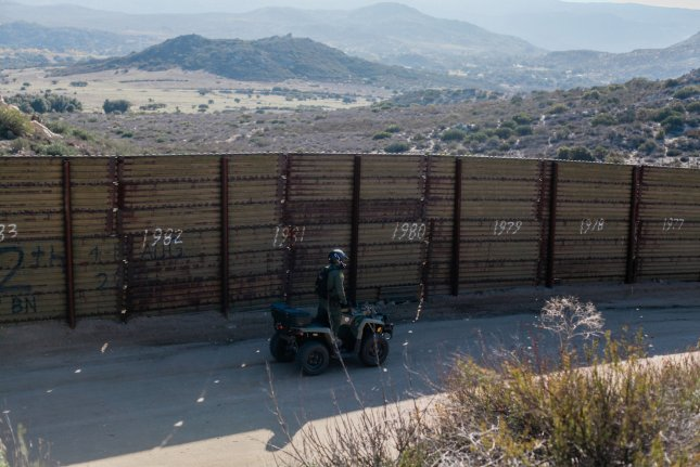 A U.S. Border Patrol agent rides an ATV in Campo, Calif., as he polices near the border fence that divides the United States and Mexico on December 16, 2018. Photo by Ariana Drehsler/UPI