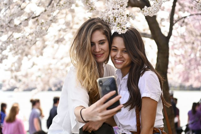 Researchers say selfie-takers may be viewed more negatively than those who post posed photos, because the latter feel more natural. File Photo by Leigh Vogel/UPI