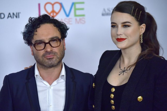 Big Bang Theory alum Johnny Galecki (L) and his girlfriend Alaina Meyer attend a gala in May. Galecki is developing a Vacation series for HBO Max. File Photo by Chris Chew/UPI