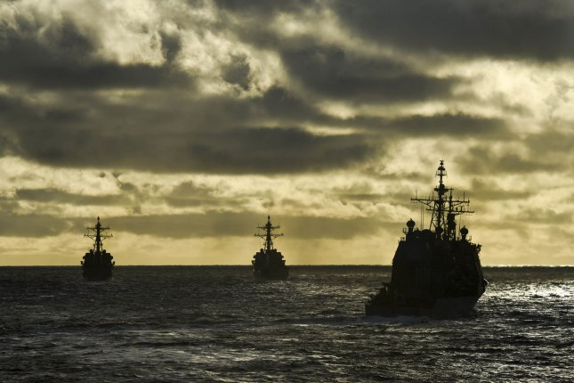 USS Howard, USS Pinckney, and USS Princeton steam in formation during a maneuvering exercise in 2016, with the Arleigh Burke-class guided missile destroyer USS Shoup. An audit released by the Department of Defense Tuesday found multiple unaddressed training deficiencies on Burke-class destroyers. Photo By Holly Herline/U.S. Navy/UPI