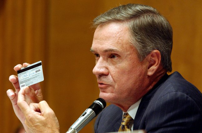 Sen. John Breaux, D-La., makes a point about the ease of identity theft during a Senate Finance subcommittee on social security and family policy hearing on Capitol Hill. The subcommittee was examining ways to protect against social security number and identity theft. Parts of Sen. Breaux's credit card have been digitally altered to protect against theft. (Roger L. Wollenberg/UPI)
