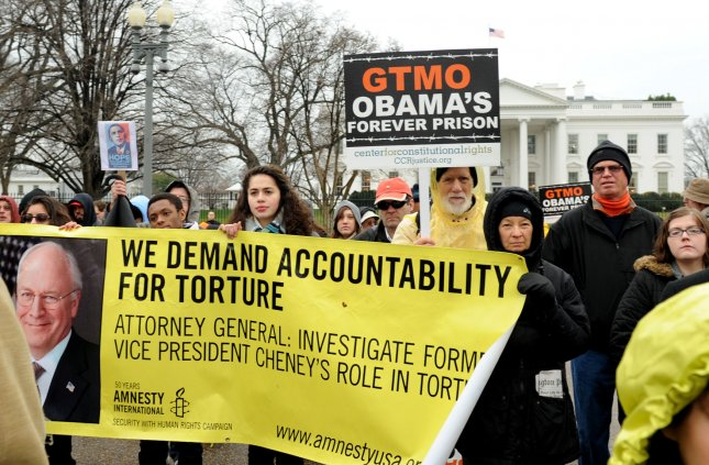 Protesters mark the 10th anniversary of the opening the Guantanamo Bay Detention Camp, in front of the White House in Washington, DC on January 11, 2012. Human-rights groups worldwide are demanding the camp be closed. Of the nearly 800 detainees taken to Guantanamo, 171 prisoners remain. UPI/Pat Benic