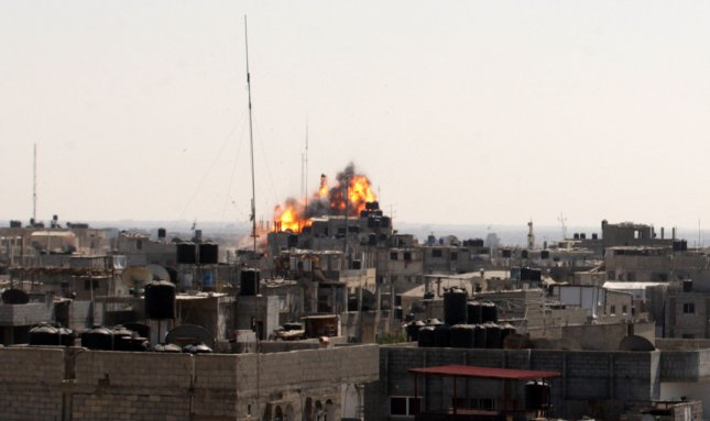 A ball of fire is seen following an Israeli air strike in Rafah in the southern Gaza on August 23, 2014. Israel kept up the pressure on Hamas in Gaza, carrying out multiple air strikes that killed seven Palestinians, three of them children, as Egypt prepared to convene new truce talks. UPI/Ismael Mohamad
