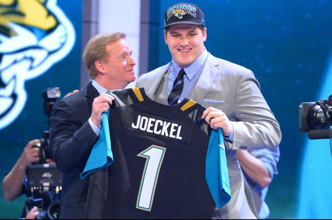 Luke Joeckel, offensive tackle from Texas A&M, holds up a Jaguars Jersey and stands next to NFL Commissioner Roger Goodell after the Jacksonville Jaguars select him as the #2 overall pick in the 2013 NFL Draft at Radio City Music Hall in New York City on April 25, 2013. UPI /Rich Kane