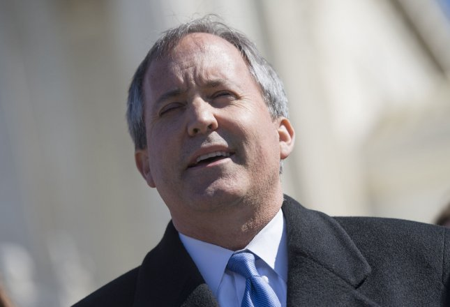 Texas Attorney General Ken Paxton speaks to the media after the Supreme Court heard arguments in the Whole Woman's Health v. Hellerstedt case, at the Supreme Court in Washington, D.C. on March 2, 2016. Paxton plans to appeal a preliminary injunction issued by U.S. District Judge Sam Sparks on Friday blocking rules equiring fetal remains from abortions or miscarriages in Texas to be buried or cremated. Photo by Kevin Dietsch/UPI