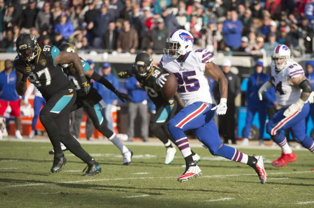 Buffalo Bills running back LeSean McCoy runs against the Jacksonville Jaguars during the fourth quarter of the NFL Wild Card game on January 7 at EverBank Field in Jacksonville, Fla. Photo by Joe Marino/Bill Cantrell