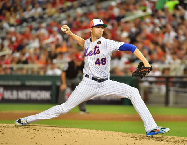 New York Mets pitcher Jacob deGrom delivers to the American League during the third inning of the MLB All-Star Game at Nationals Park in Washington, D.C., on Tuesday. Photo by Kevin Dietsch/UPI