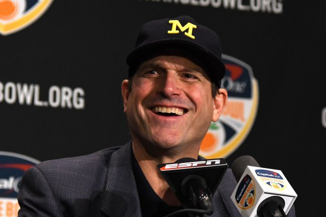Michigan Wolverines coach Jim Harbaugh answers questions from the media during the 2016 Orange Bowl coaches press conference at the Renaissance Fort Lauderdale Cruise Port Hotel. Photo by Gary I Rothstein/UPI